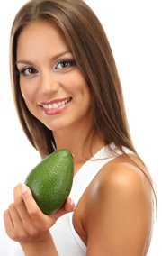 smiling-young-woman-holding-an-avocado